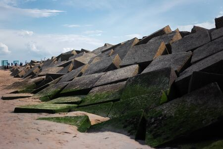 Landscape of big stoned cubes on the seaside.