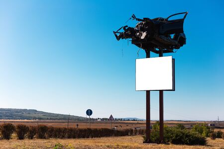 Billboard blank for outdoor advertising poster about dangerous cars crash on road, with smashed car on top.