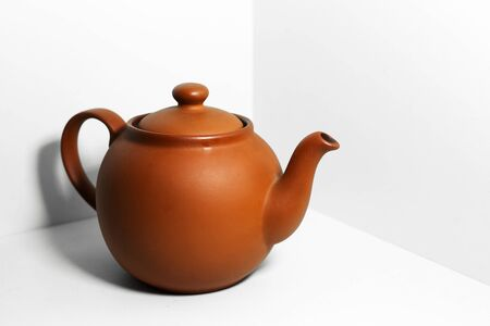 Close-up of teapot isolated on white background.