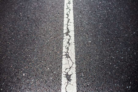 White dividing line on asphalting road.