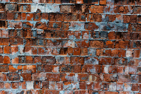 Natural abstract textured background of abandoned red brick wall.