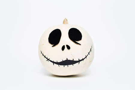 Studio portrait of white halloween smiling pumpkin, on white background. Stok Fotoğraf