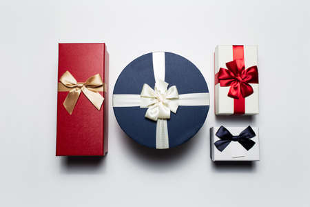 Close-up of colorful Christmas gift boxes isolated on white background. Stok Fotoğraf