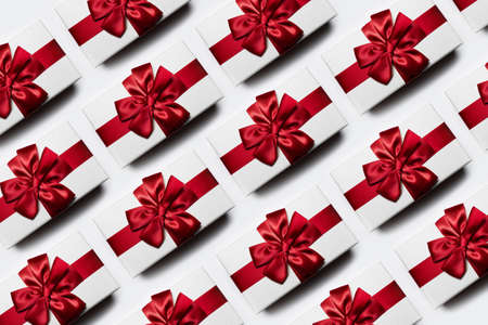 Christmas pattern of white gift boxes with red bow, isolated white background. Stok Fotoğraf