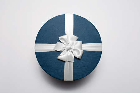 Top view of round gift box isolated on white background.