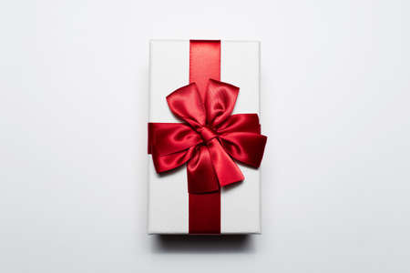 Close-up of white gift box with red bow, isolated on white background. Stok Fotoğraf