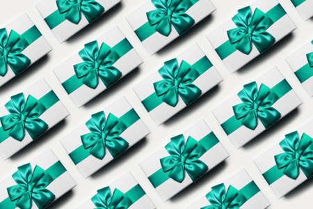 Christmas pattern of white gift boxes with bow of aqua menthe color, isolated on white background. Stok Fotoğraf