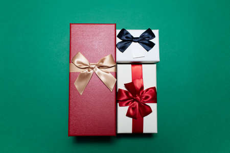 Close-up of three gift boxes on green background. Stok Fotoğraf