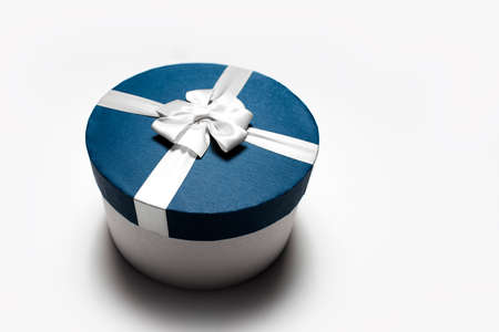 Close-up of blue round gift box with bow isolated on white background with copy space. Stok Fotoğraf