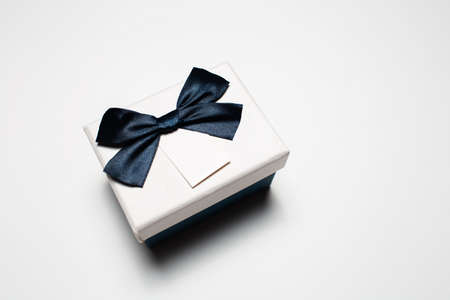 Close-up of small gift box with bow isolated on white background. Stok Fotoğraf