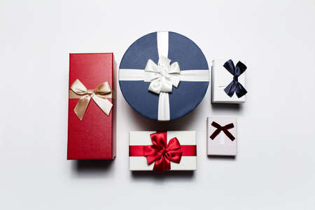 Top view of different gift boxes isolated on white background.