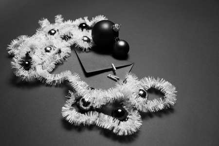 Black and white photo of envelope decorated with Christmas ornaments.