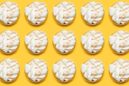 Pattern of white chips in round bowls on orange background.