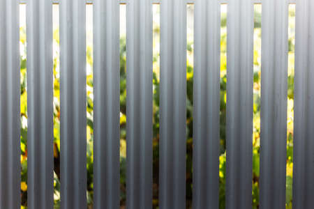 Natural abstract background of metal fence in shape of lines.