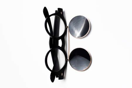 Close-up of round sunglasses of black isolated on white background.