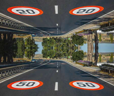 Parallel universe, world; close-up view of two 50 km per hour, speed limit signs painted on asphalting road. Artwork collage concept.