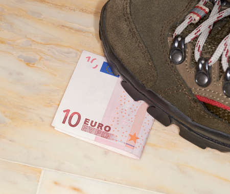 time critical: Euros trampled, concept of bad economy and critical time be addressed Stock Photo