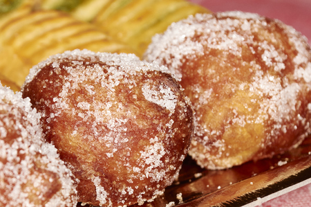 zeppole: Italian sweet called zeppole stuffed with apple and cream covered with crystal sugar Stock Photo