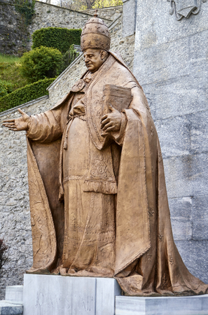 beatification: Under Mont, Lombardy, Italy - April 2014: La big statue of pope john twentieth third at the shrine of Our Lady of the woods of Imbersago in the province of Lecco in the Lombardy region Italy Editorial