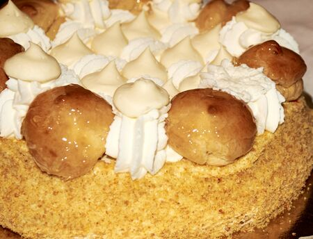 recipe decorated: Birthday cake with whipped cream and cream puffs, natural ingredients flour sugar milk Stock Photo