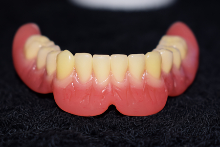 Detail of the lower dental prosthesis in resin and composite