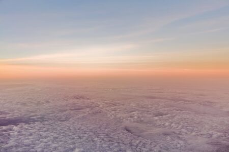 Horizon of the sky during a sunset or sunrise over clouds