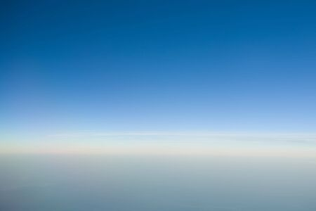Blue sky horizon with some clouds 免版税图像