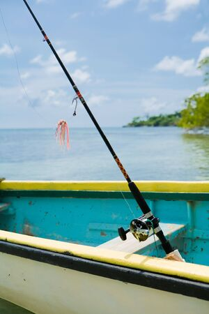 Close up of fishing boat with fishing poles in the water