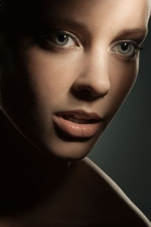 Beauty image of woman's face in shadows
