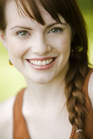 Close-up portrait of a young pretty woman smiling Stock Photo - 5438784