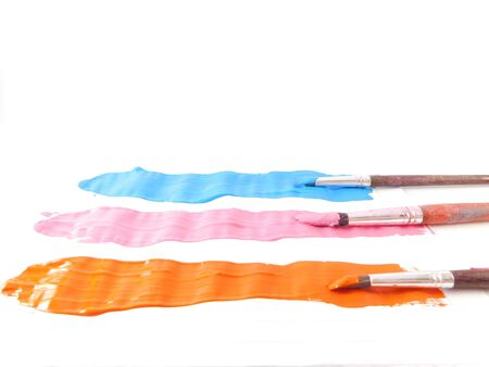 orange roses: Three brushes and three lines of paint celestial of, pink and orange color. Stock Photo