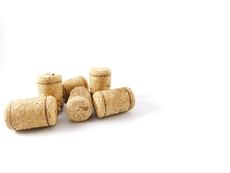 Six corks of bottles together and scattered.