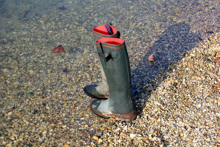 muddy clothes: Pair of gumboots