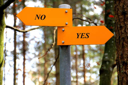 rev: No and yes written on a hiking sign