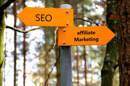 affiliate: Seo and affiliate marketing written on a sign