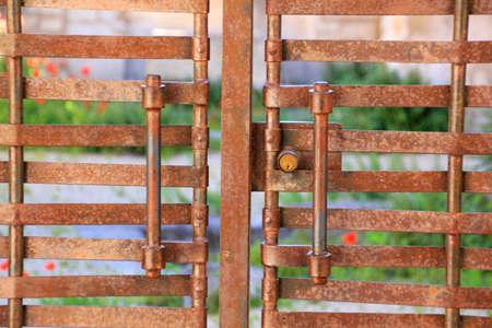 metal gate: handles of a metal gate Stock Photo