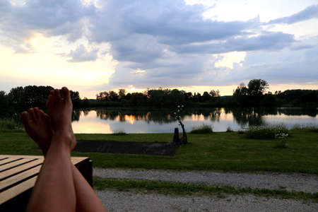 Girl enjoys the view to the lake