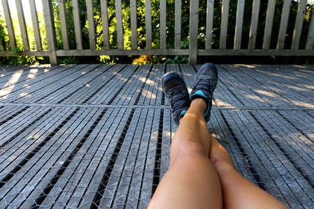 Girl takes a break from a wooden bridge