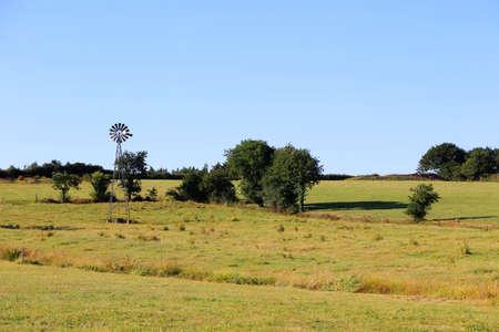 Rustic waterpump on a field in france