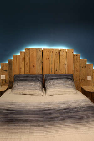 Rustic bed made of pallets with a modern LED light Zdjęcie Seryjne