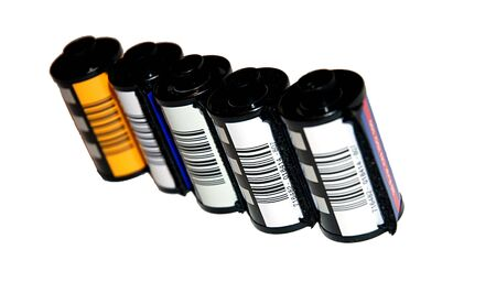 A row of film cartridges over a white background photo