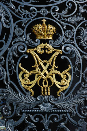 Zar  symbol on winter palace gates in Russia photo