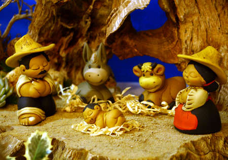 nativity with mexican holy family  in a manger at christmas photo