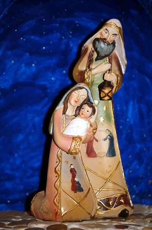 nativity with holy family  in a manger at christmas with blue sky photo