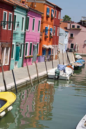 colorful houses along the canal on the island of Burano near Venice Stock Photo - 8528671