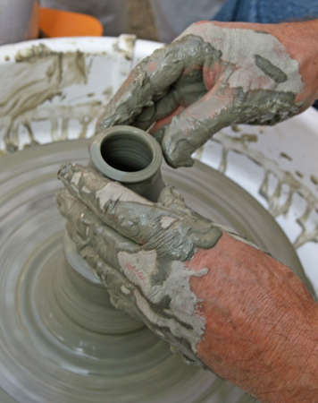 skilled artisan potter during the production of a vessel of clay and clay  Stock Photo - 8757017