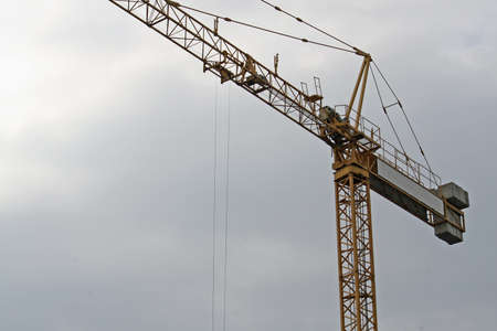 crane on a construction site for the construction of a residential and commercial building photo