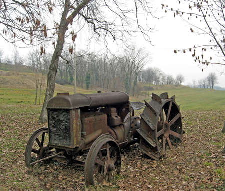 old farm: old rusty tractor abandoned in the countryside during the autumn  Stock Photo