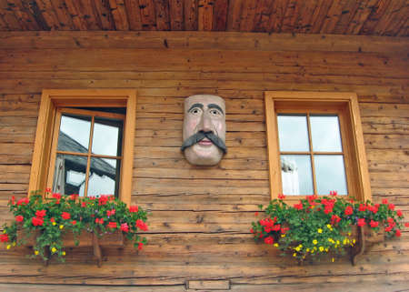 flowered wooden balconies with a mask Tyrolean Stock Photo - 9084770