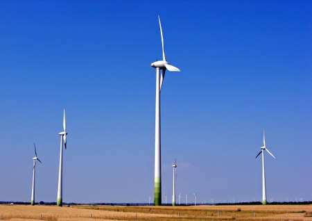 a series of wind turbines that produce green renewable energy in Poland  photo
